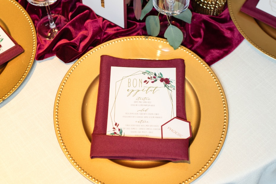 gold and burgundy table place setting