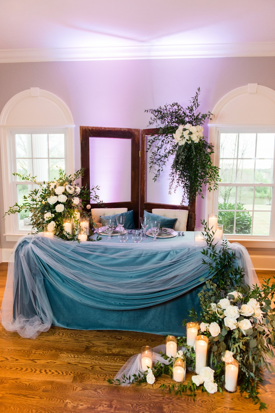 sweetheart table in blue velvet and cascading florals