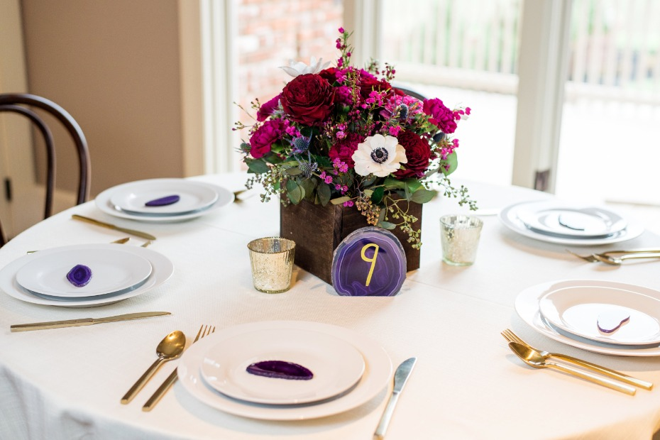 flower box and geode wedding table decor