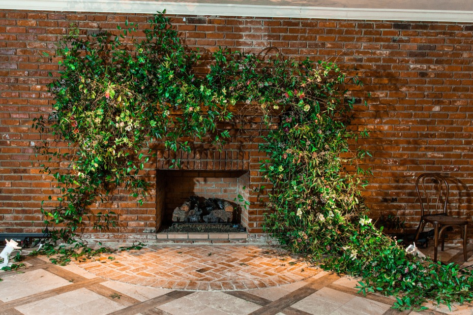 overgrown fireplace wedding ceremony backdrop idea