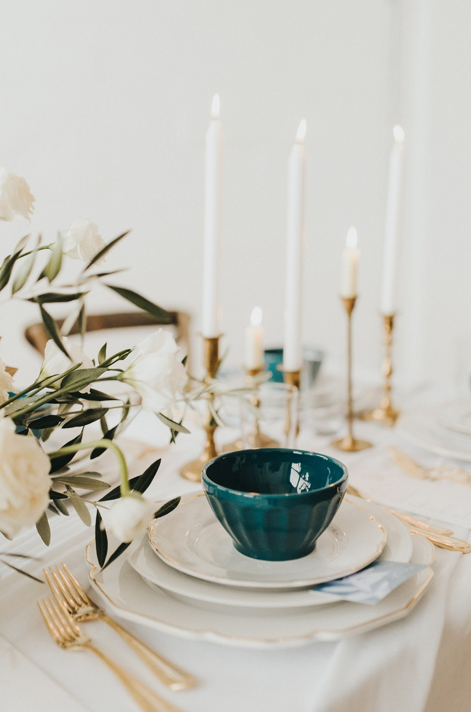 gold white and deep teal wedding table decor