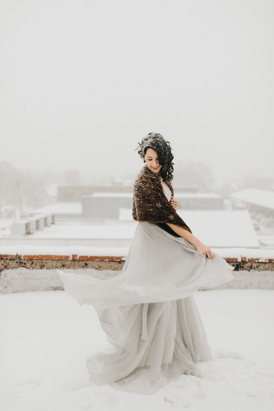 bride twirling in the snow