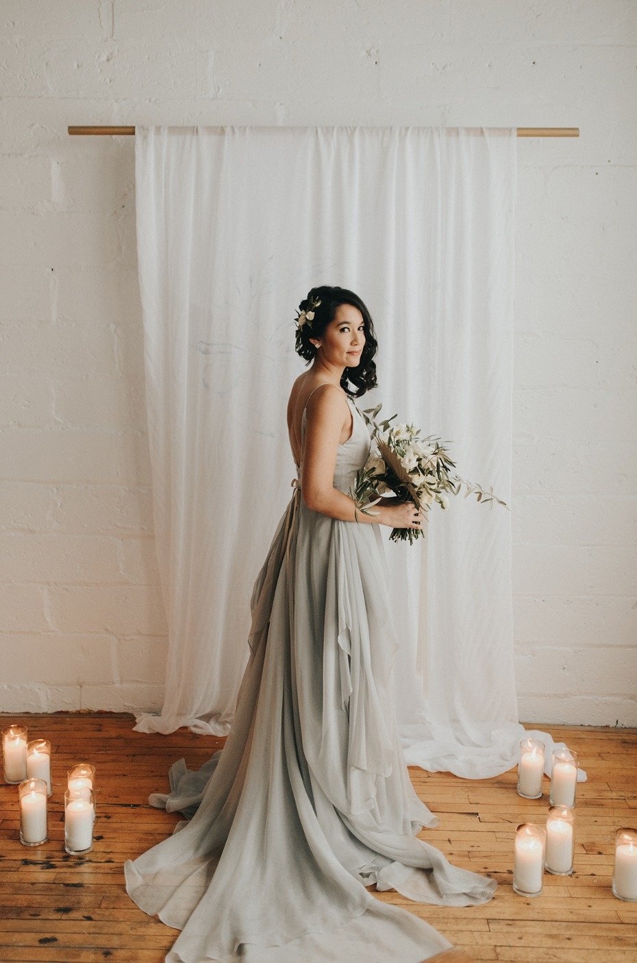 bride in elegant and modern soft grey dress