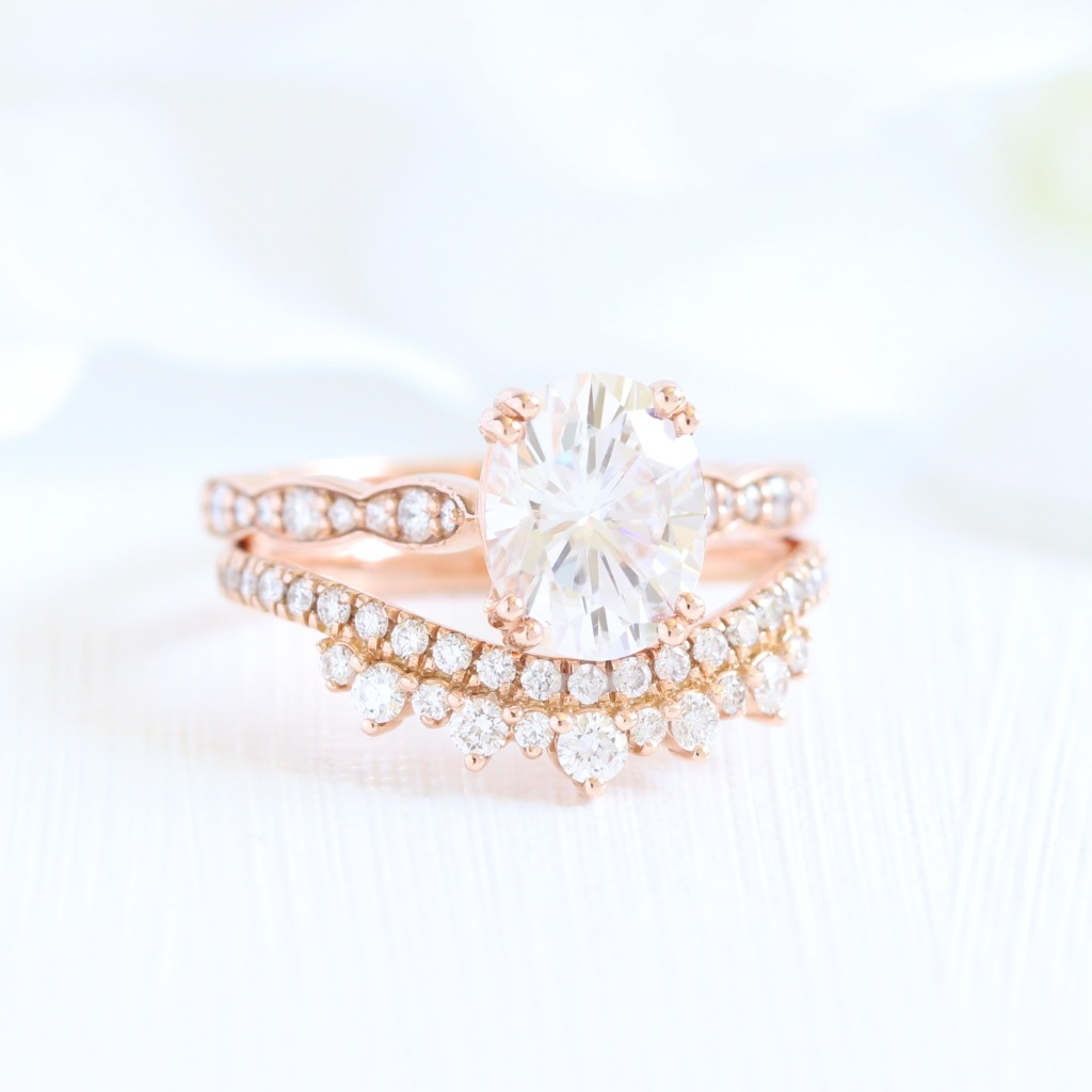Graceful bridal set of Oval Moissanite Solitaire Engagement Ring in Scalloped Diamond Band paired with a Crown Diamond Wedding Band