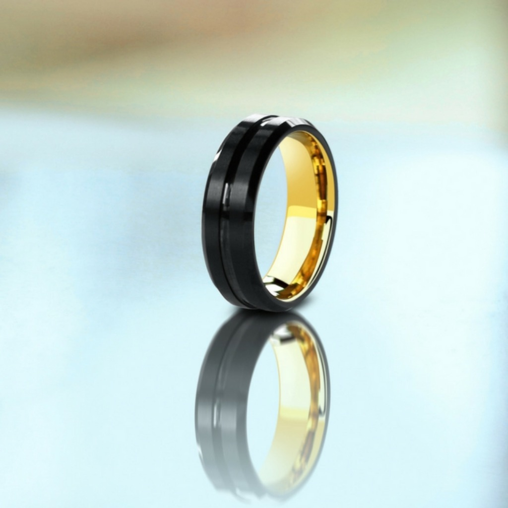 Mens black and yellow gold tungsten wedding ring. The perfect combination of modern and classic.