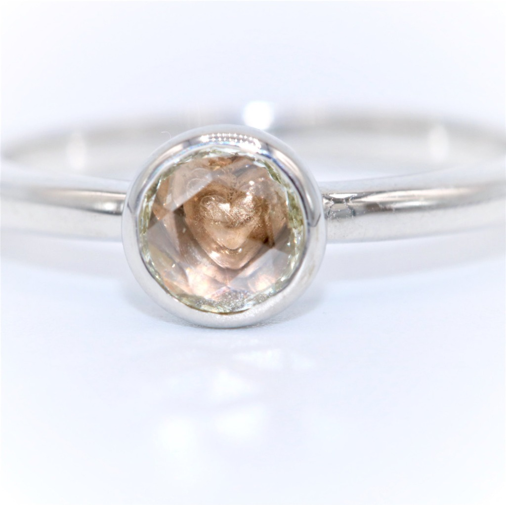 Very romantic one of a kind ring custom made with VS rose cut diamond (.2 carat approx.) through which you can see the pink heart hidden