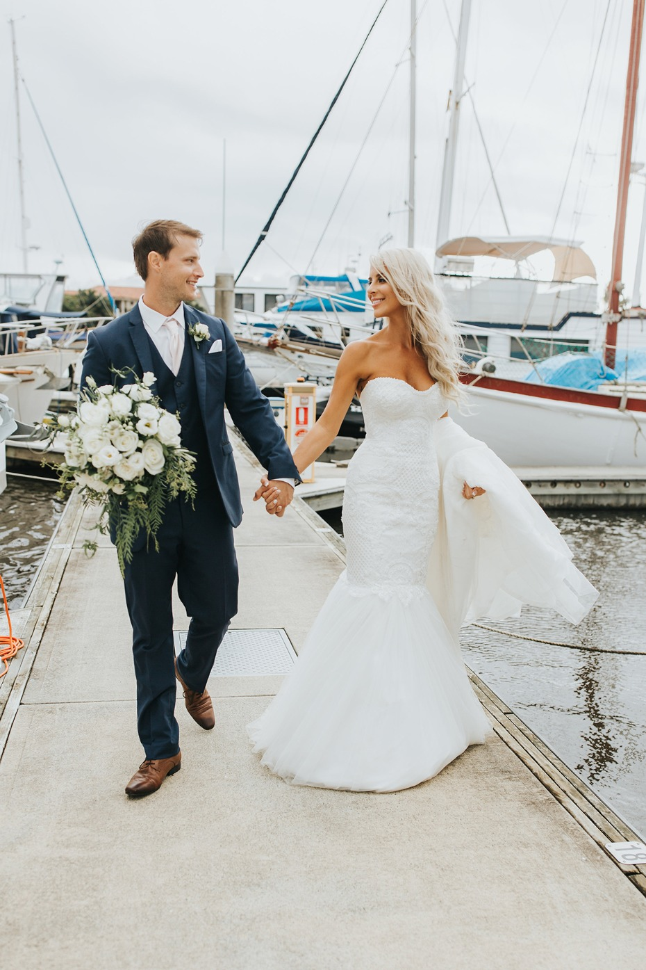 bride and groom at the dock