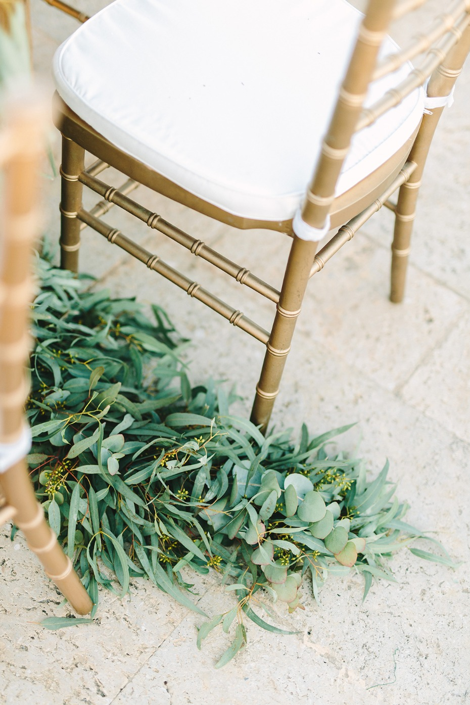 gold chairs and greenery decor