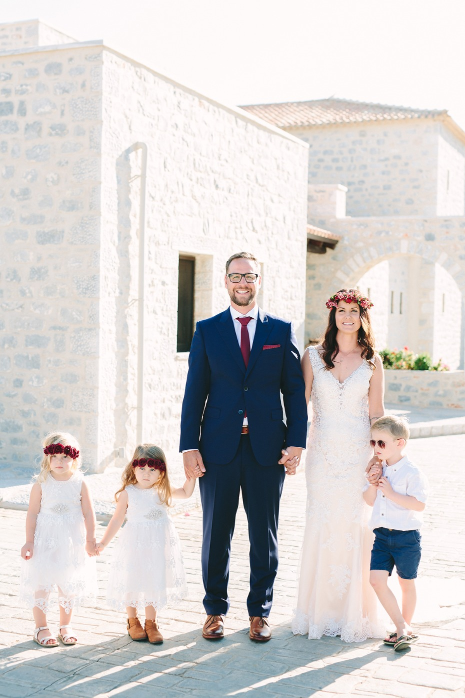 bride groom and their flower girls and ring bearer