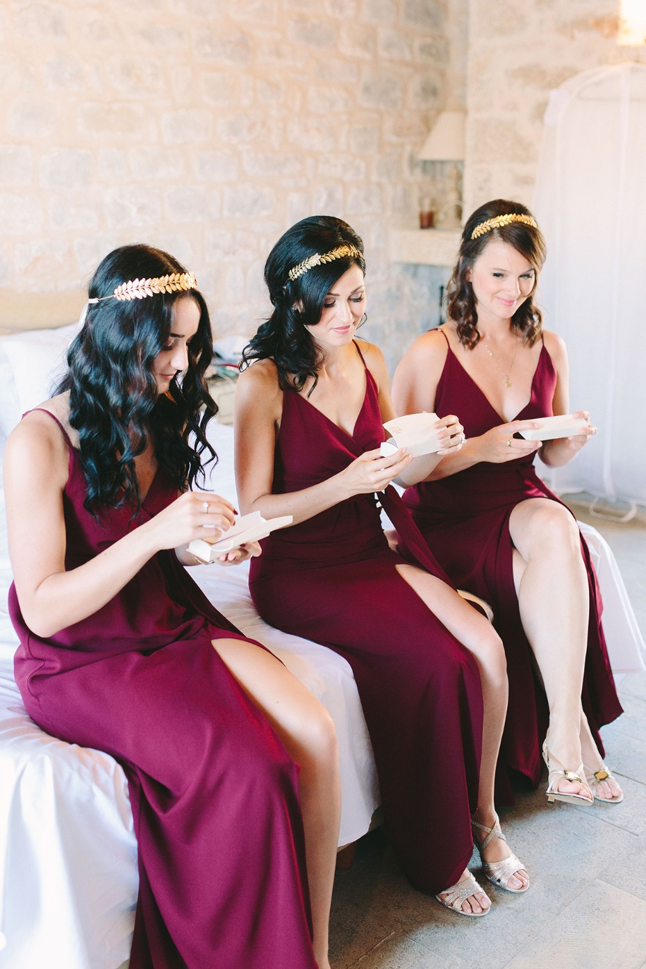 bridesmaids in golden halos and deep red dresses