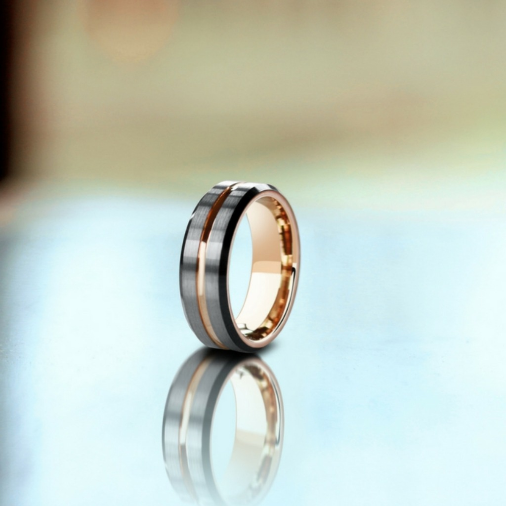 Mens three tone wedding ring. Modern black, rose gold, and brushed silver. This men's wedding ring is extremely durable and comfortable