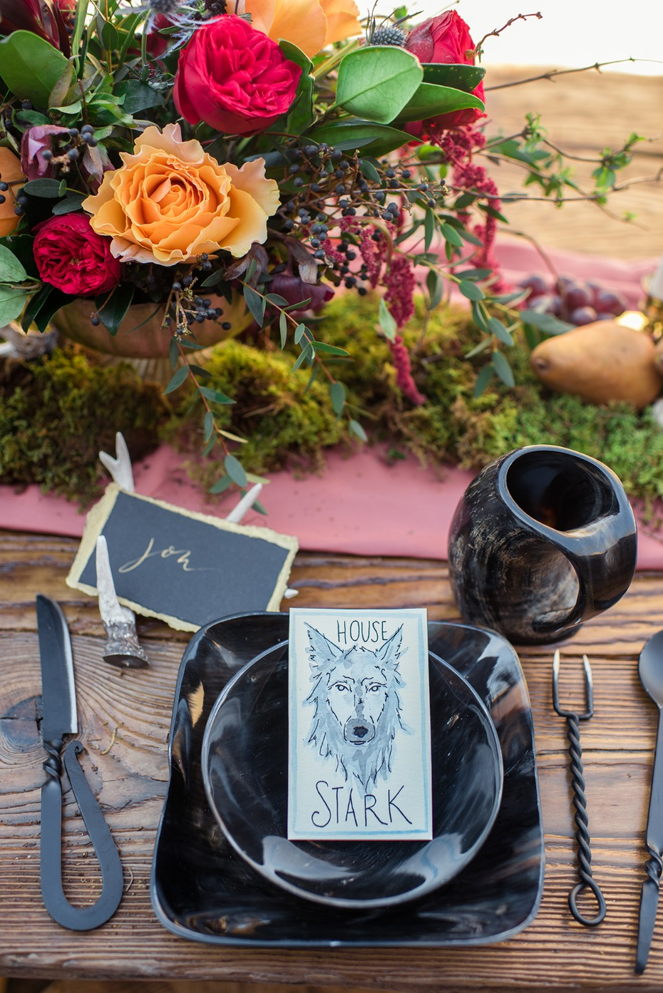 black and gold wedding place setting with a Game of Throne theme