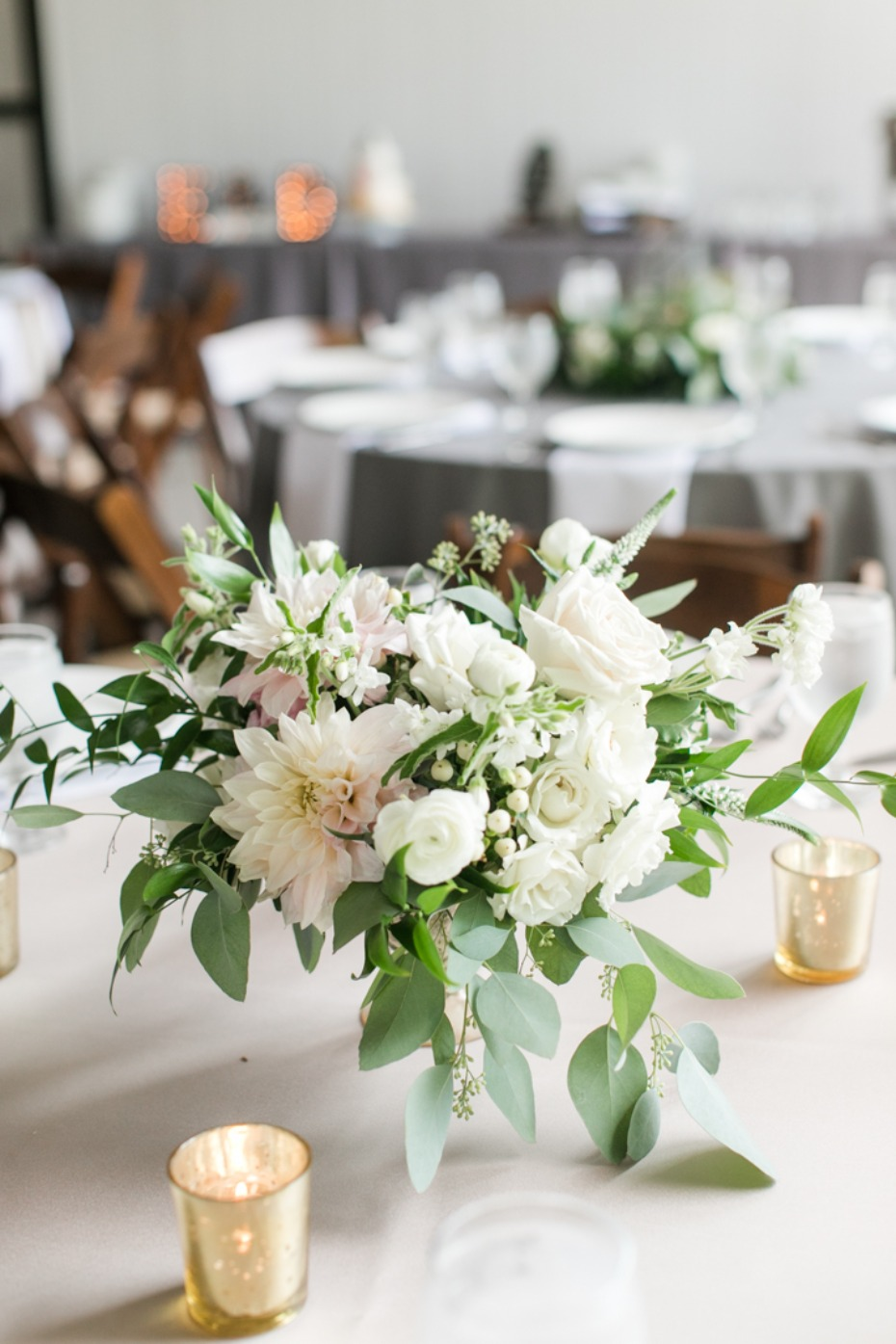 White floral centerpiece with candles