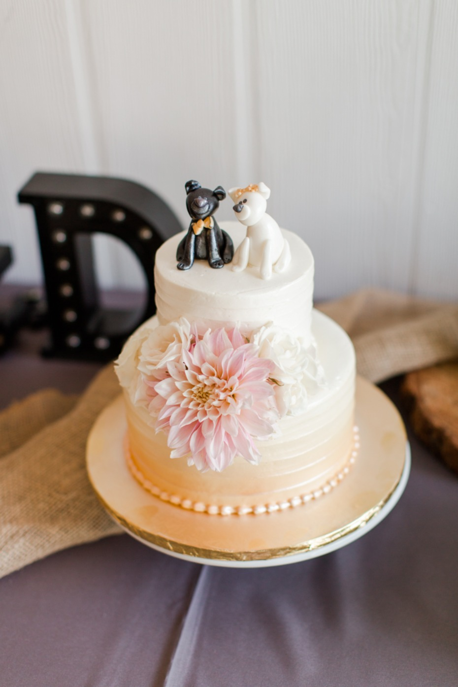 Orange ombre wedding cake with florals