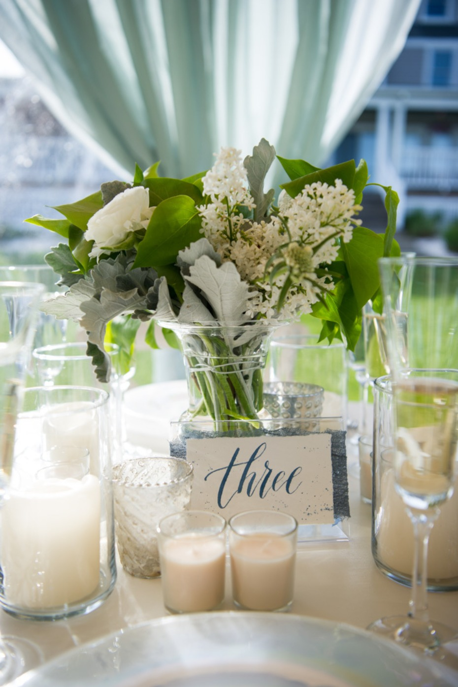 fresh white and and soft blue wedding table number