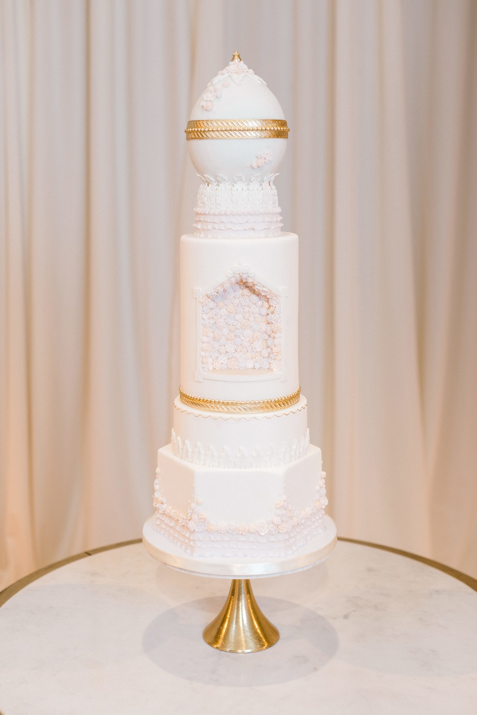 Faberge egg inspired wedding cake in gold and white