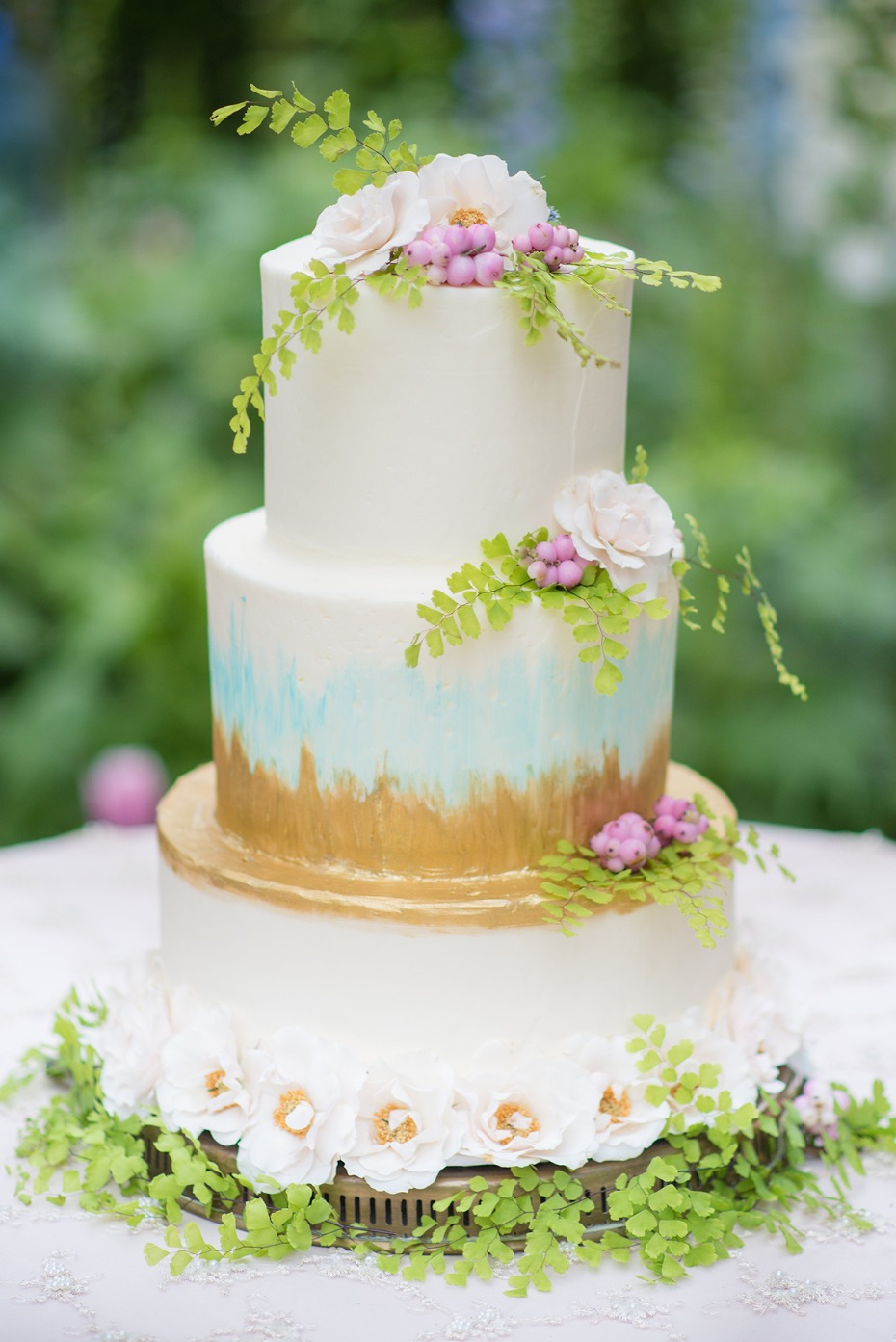 painted wedding cake in gold and teal