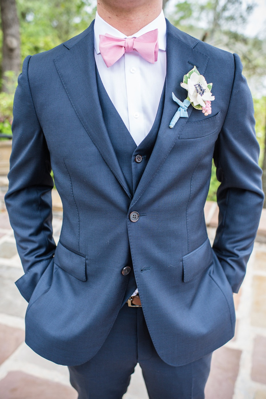 navy groom suit with pink bow tie
