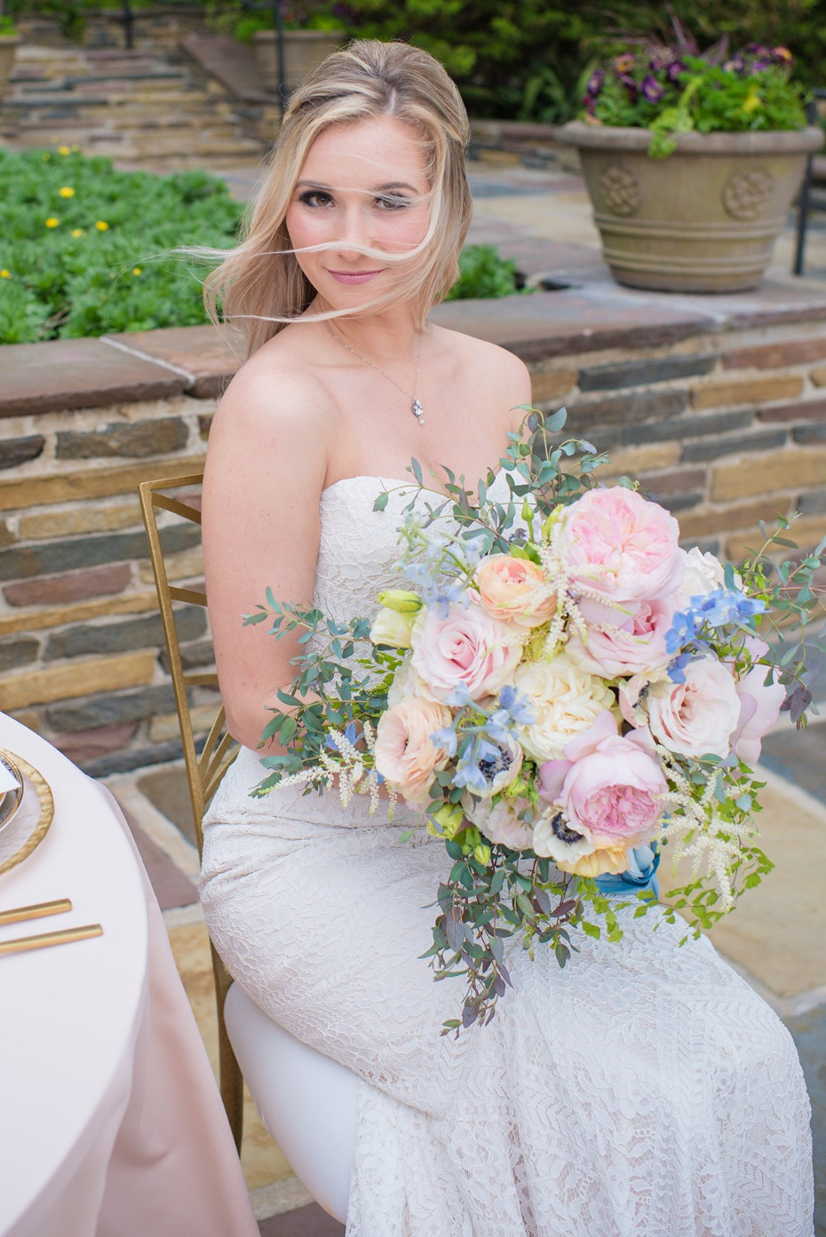 a bride and her pastel bouquet