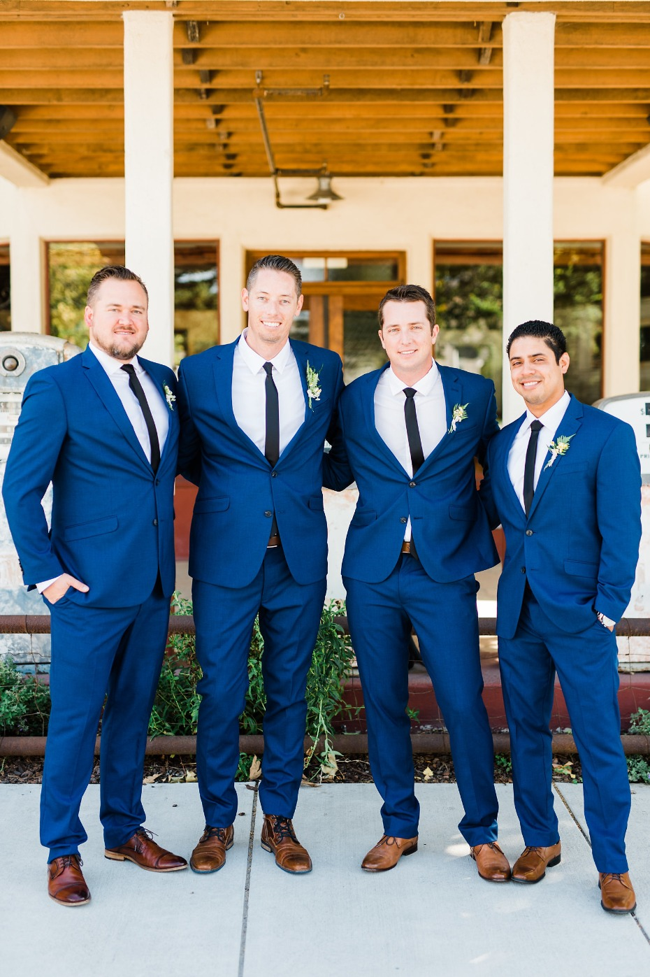 Groom and his men in navy suits