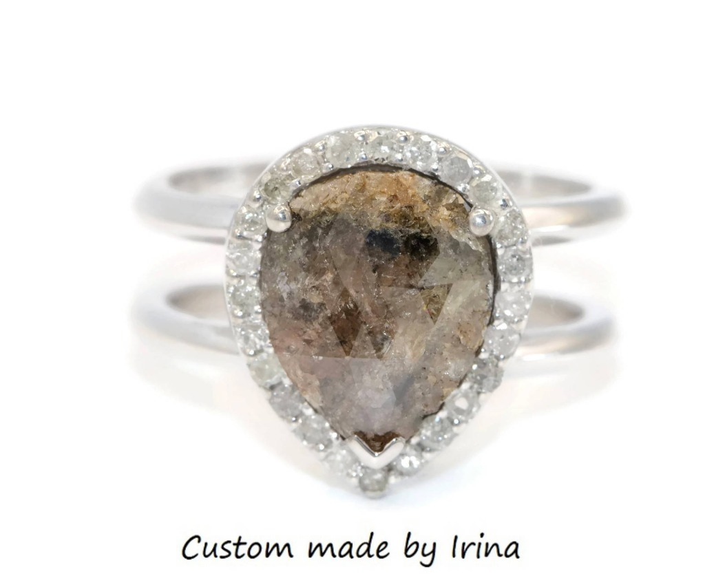 Rustic pear shape gray diamond cage ring.