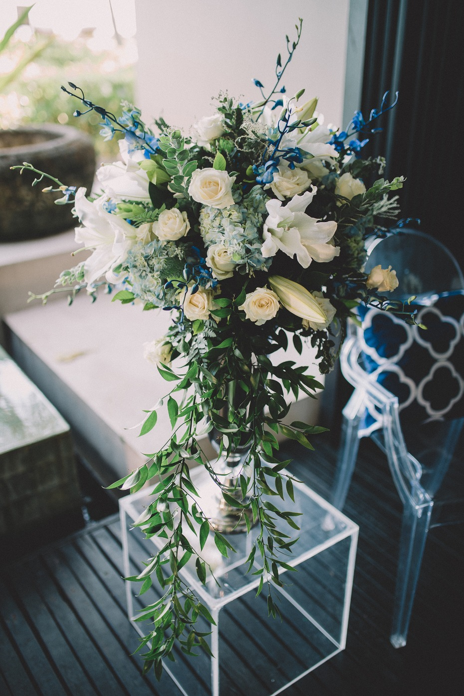 Blue and white ceremony florals