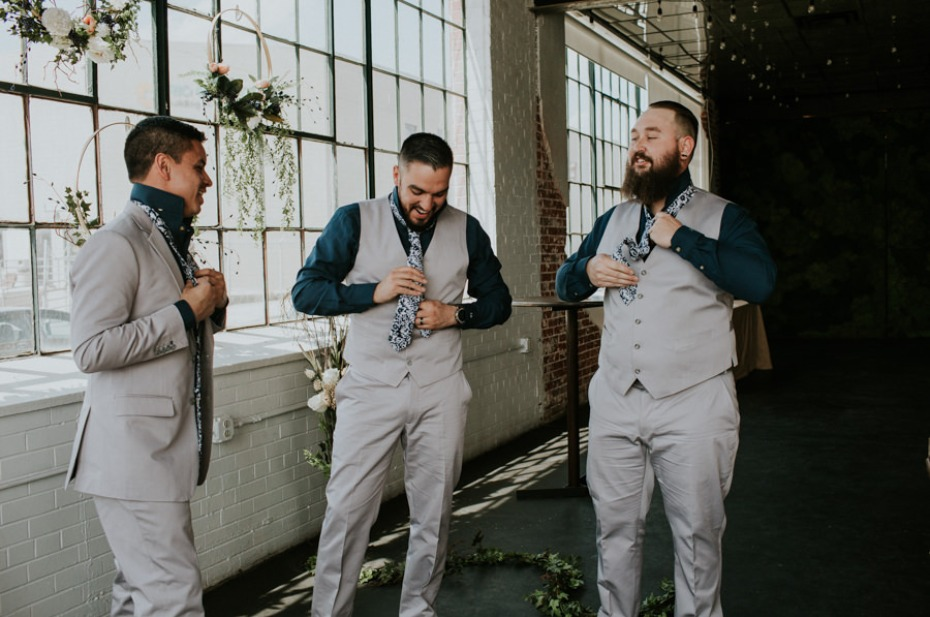 groom and his men in light grey suits
