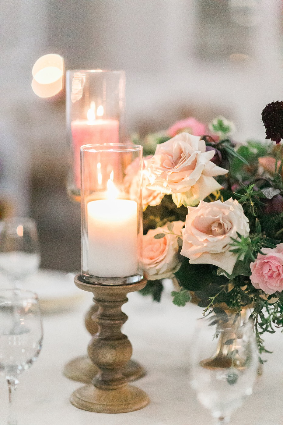 Pillar candles and roses centerpiece