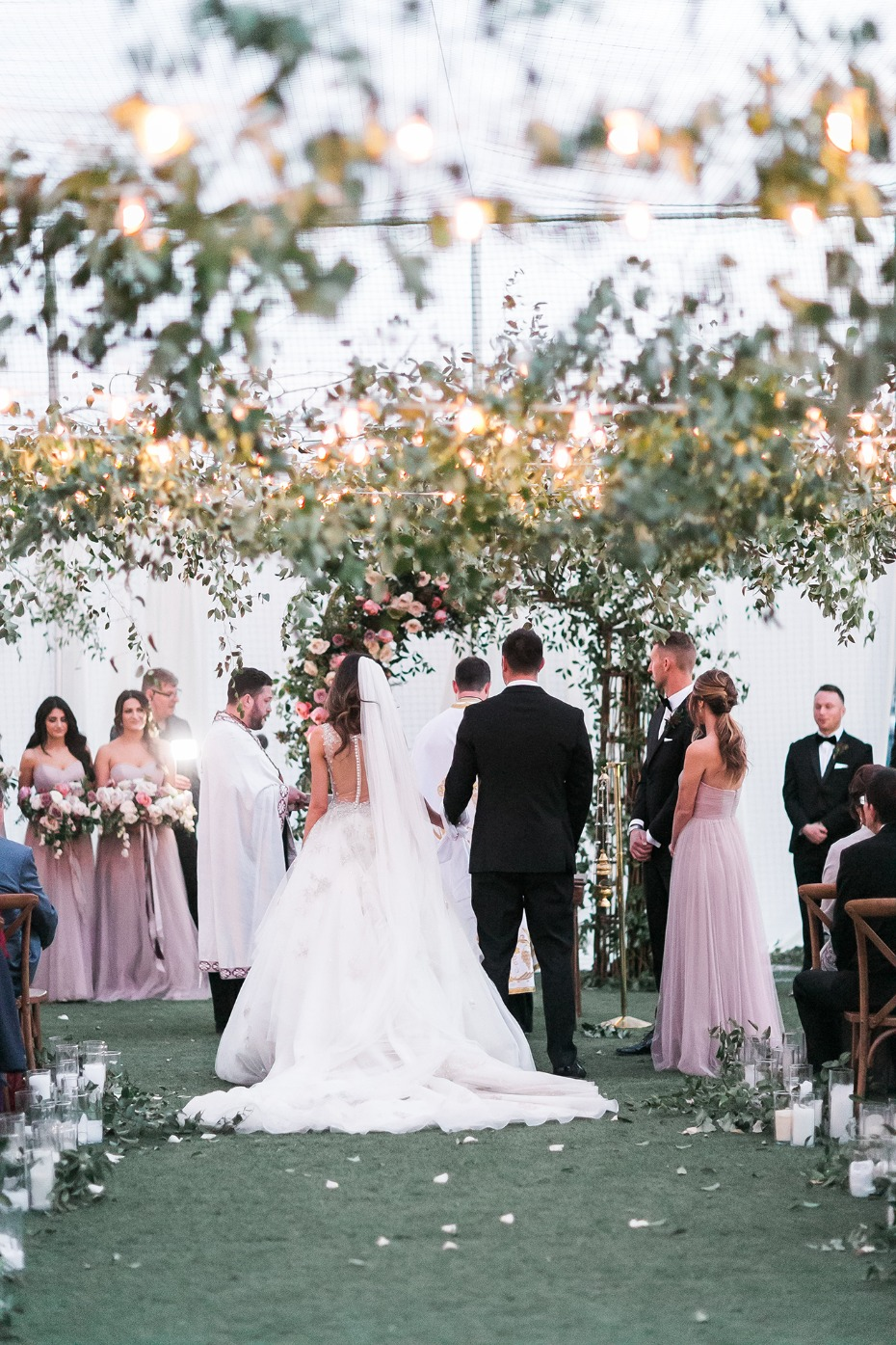 Romantic ceremony under a canopy of greenery