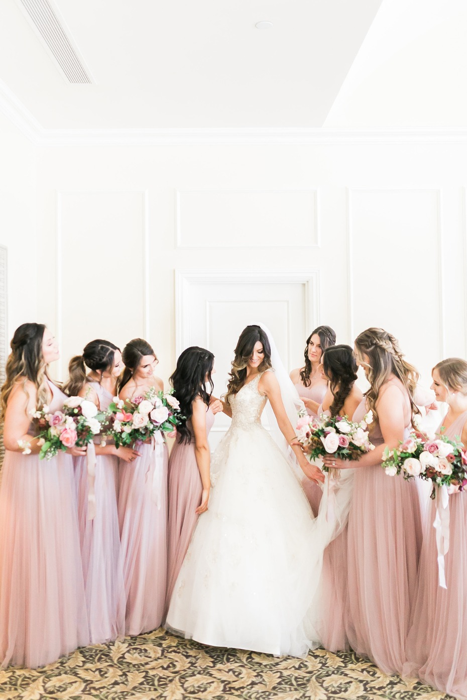 Bridesmaids in blush tulle dresses