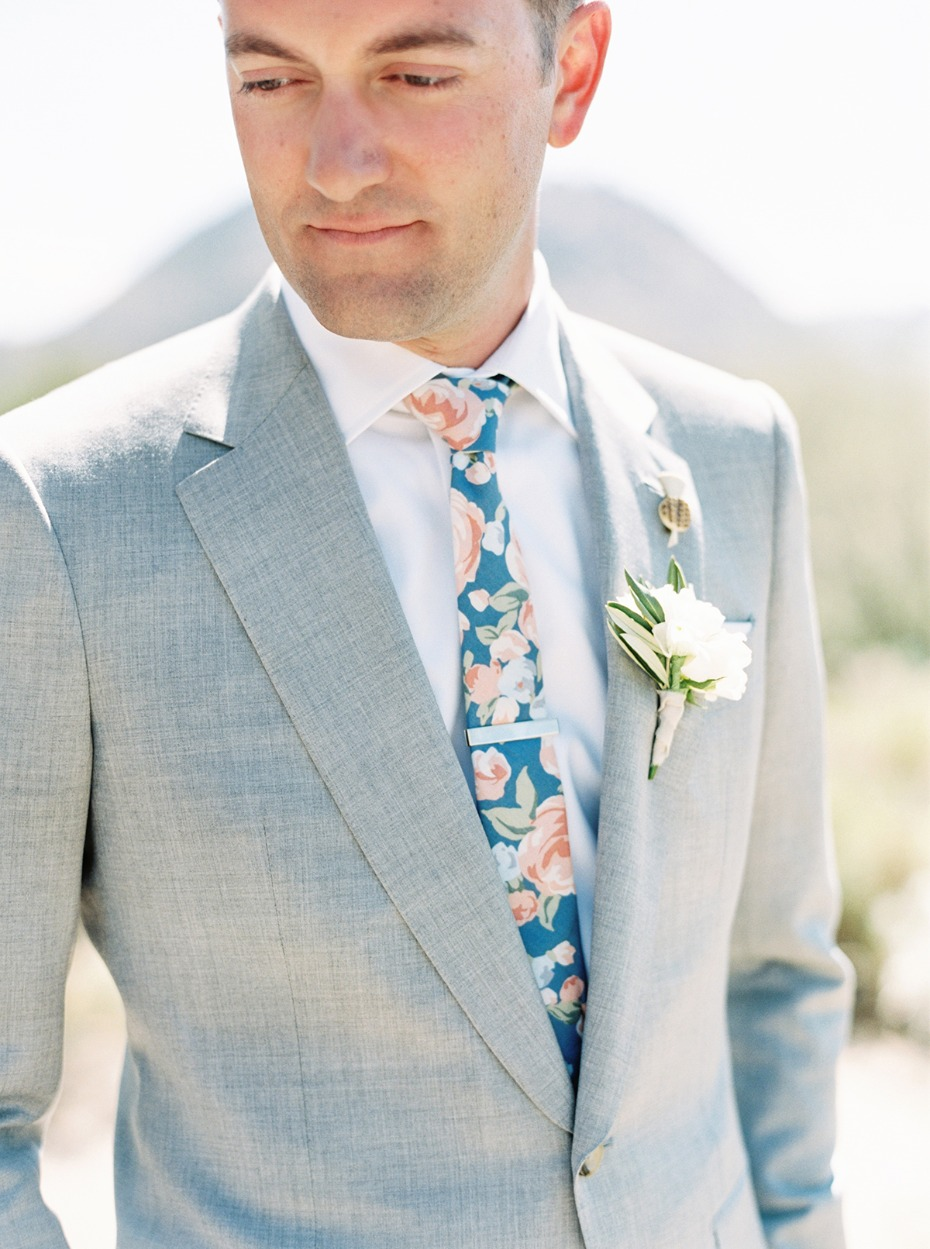 groom in heather grey suit and floral print tie