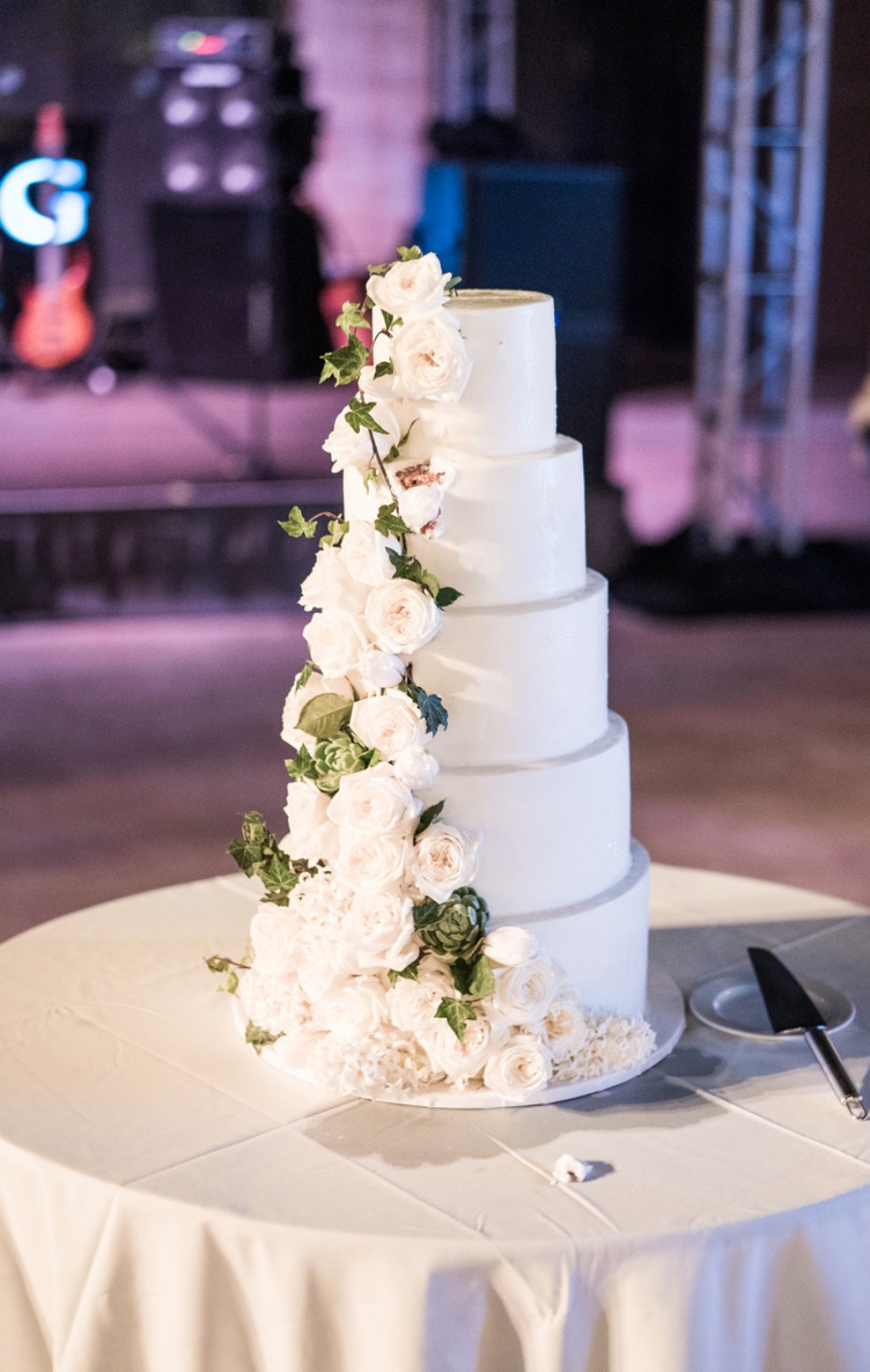 White wedding cake with white roses