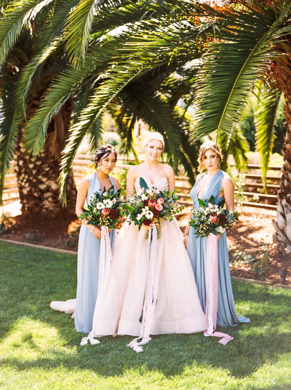 Blush wedding dress and blue bridesmaid dresses