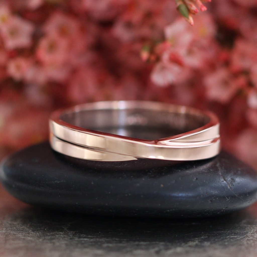 We hope your love is lasts for eternity ~ Shop more men's wedding bands such as this Infinity Knot Rose Gold Band by visiting La More