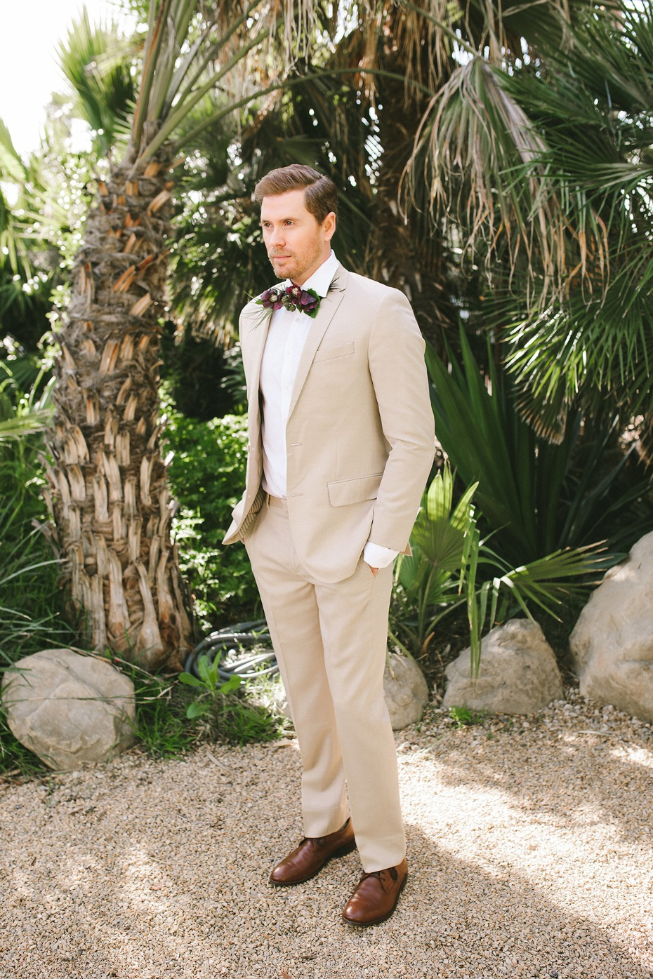 groom in sand colored tuxedo and white shirt