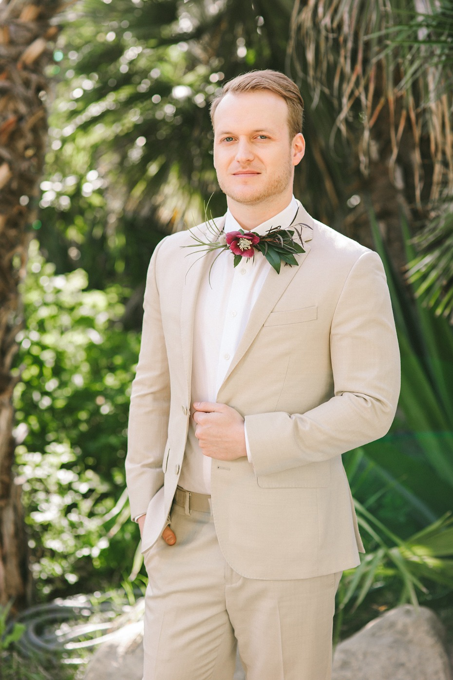 groom in sand colored wedding suit
