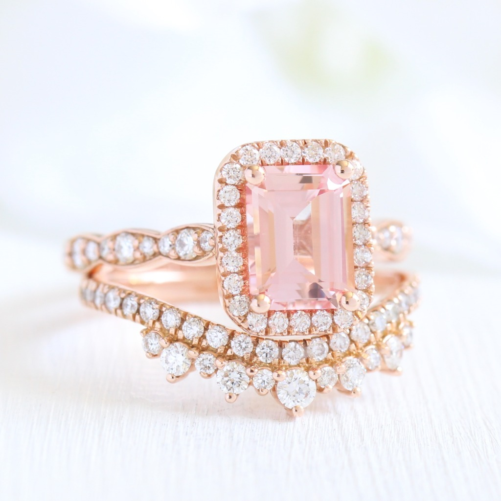 More and more Emerald cuts are making their way to our website! Take a look at this stunning Emerald Cut Peach Sapphire Halo Engagement