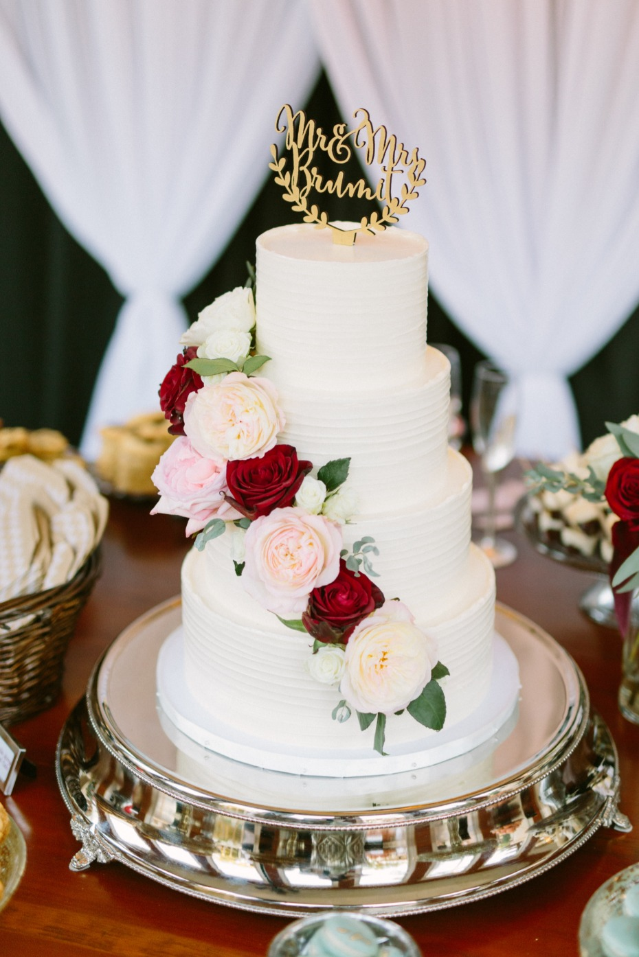 White wedding cake with cascading roses