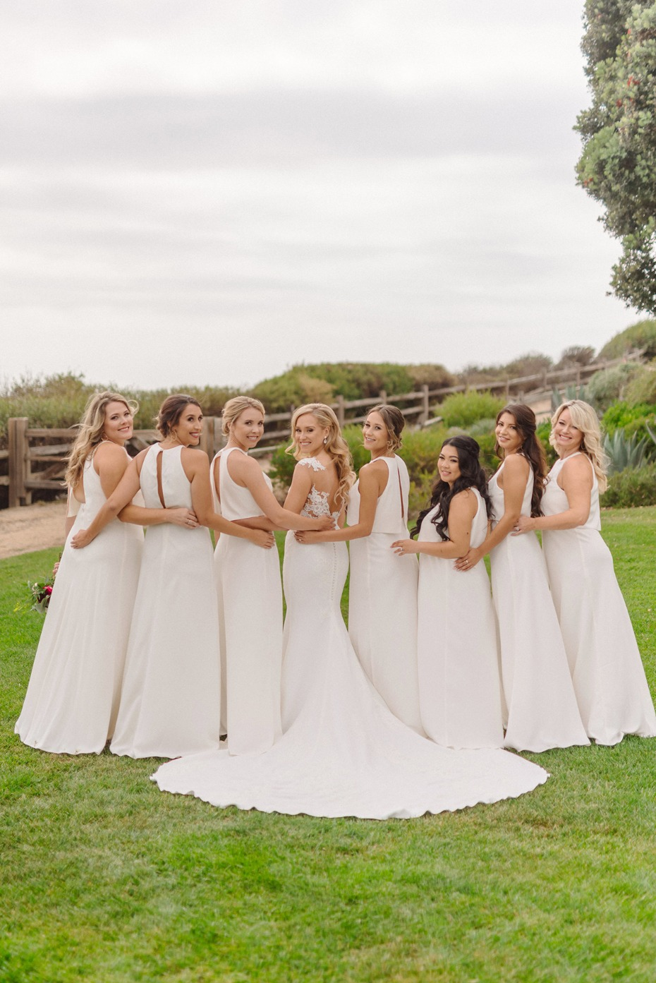 bride and her bridesmaids all in white