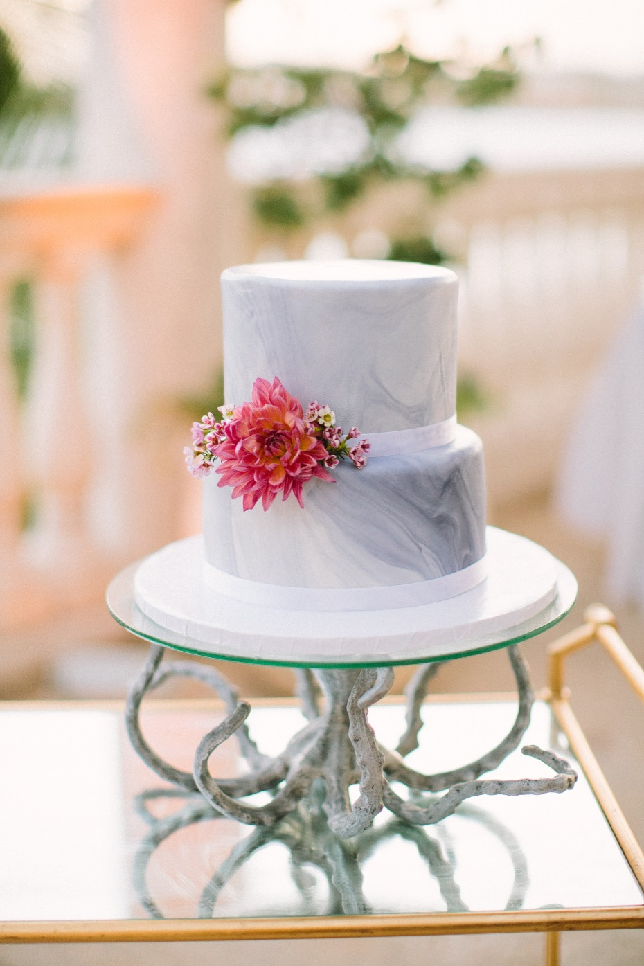 Marble wedding cake with octopus cake stand