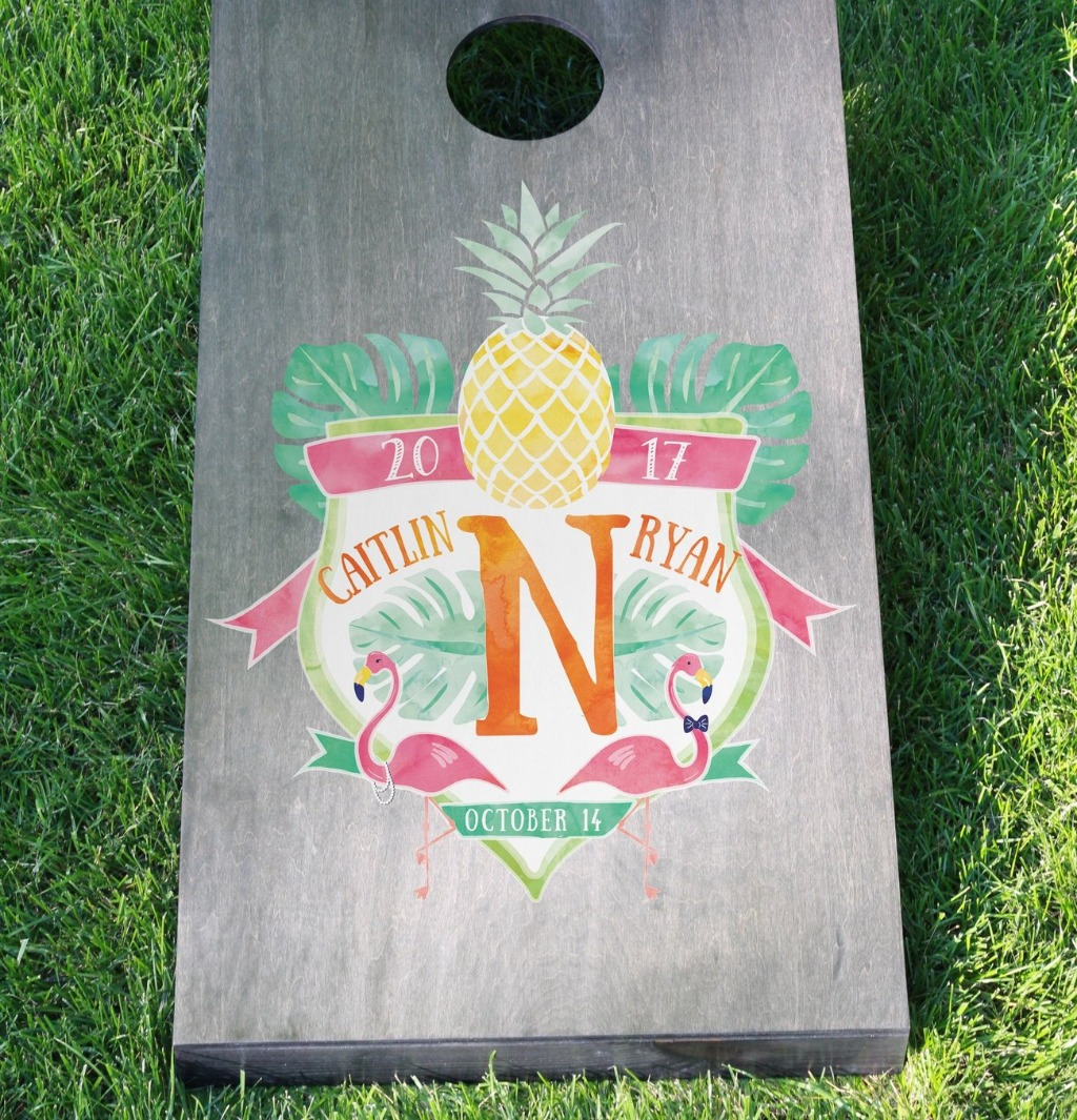 Wedding games are super fun, so pick up this awesome Custom Watercolor Crest Cornhole Board Set from Miss Design Berry for your big