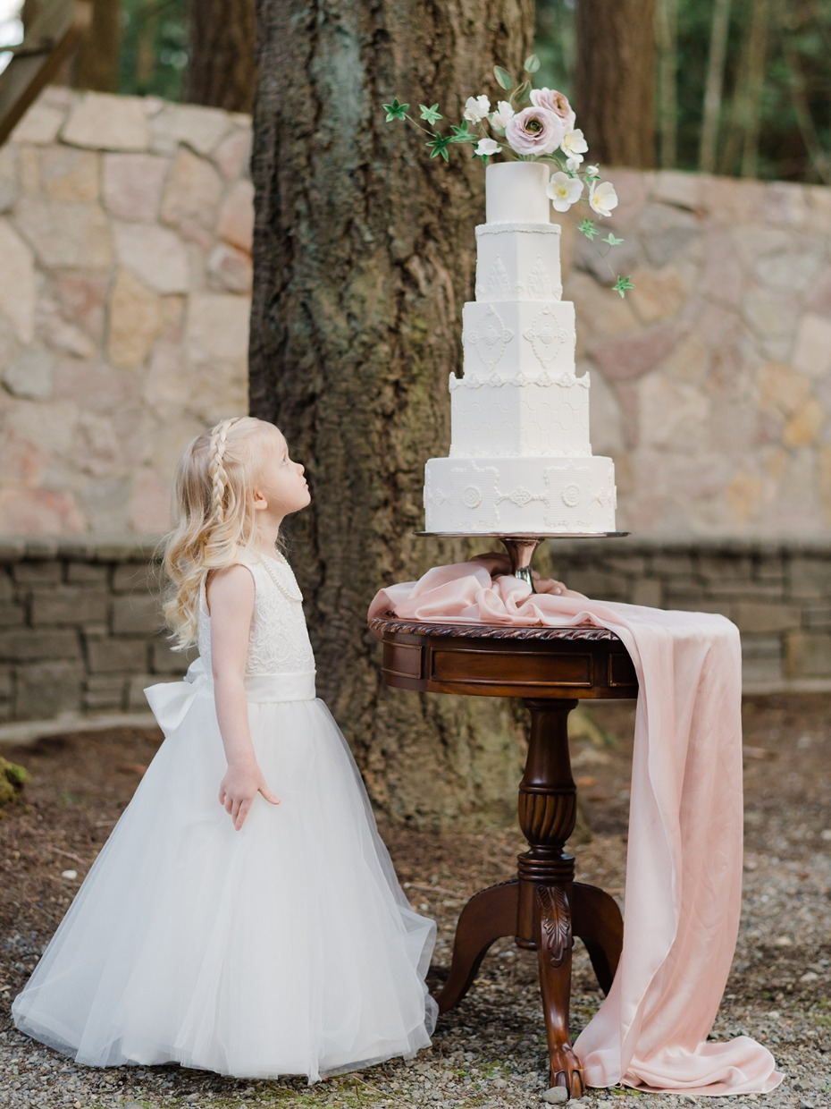 sweet little flower girl and wedding cake