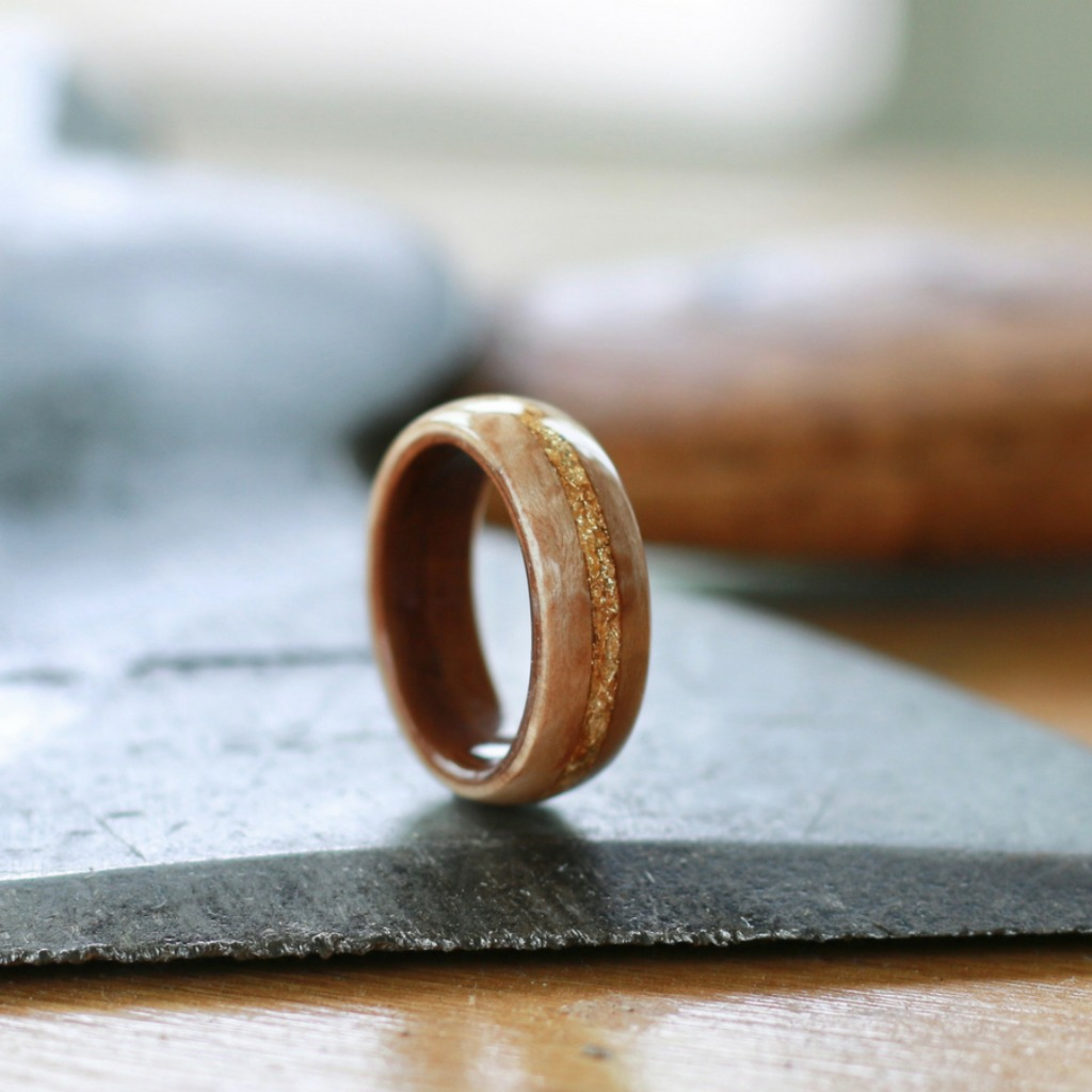 Handcrafted bentwood wedding ring. Crafted out of koa wood and maple wood. 18k gold flakes are Inlaid through the center of the ring