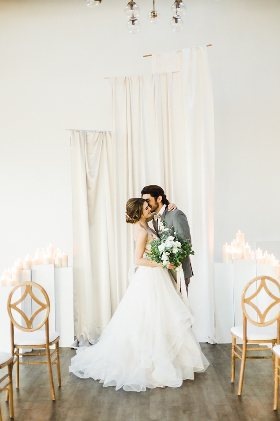 simple all white wedding ceremony backdrop