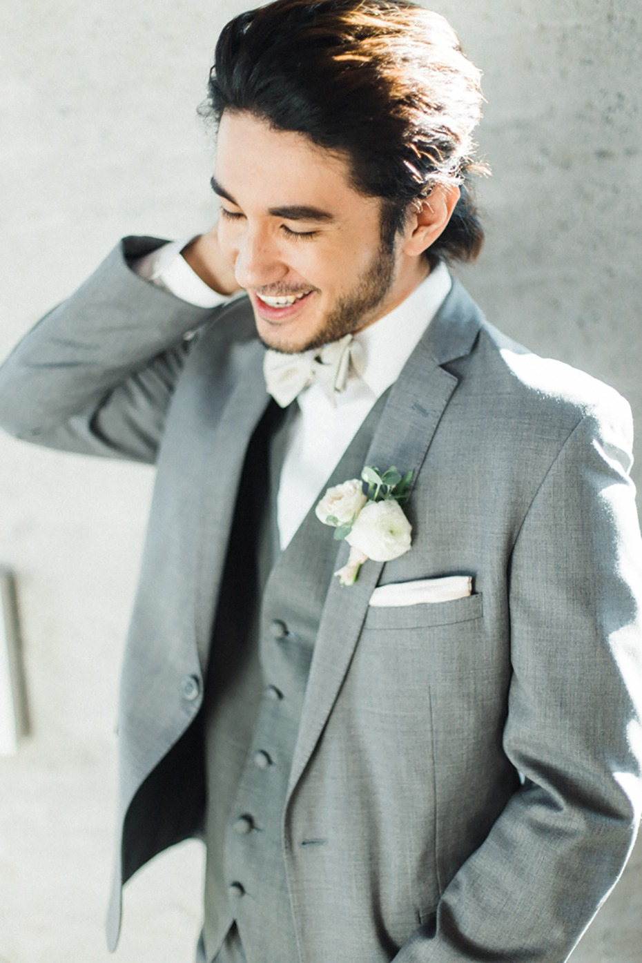 groom in heather gray and white