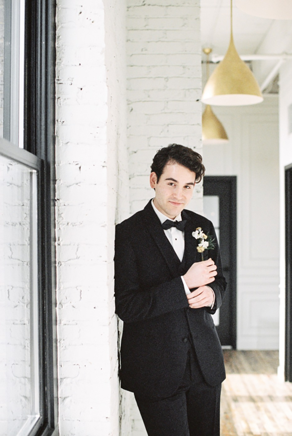 groom in black tuxedo