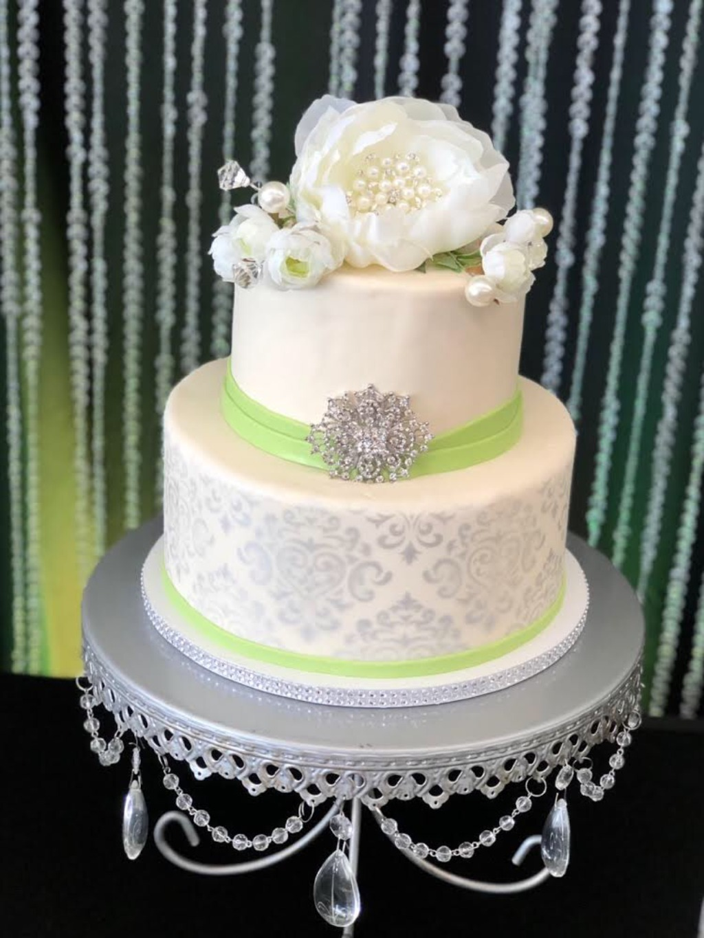 Ivory and Antique Silver Wedding Cake on Antique Silver Chandelier Cake Stand created by Opulent Treasures