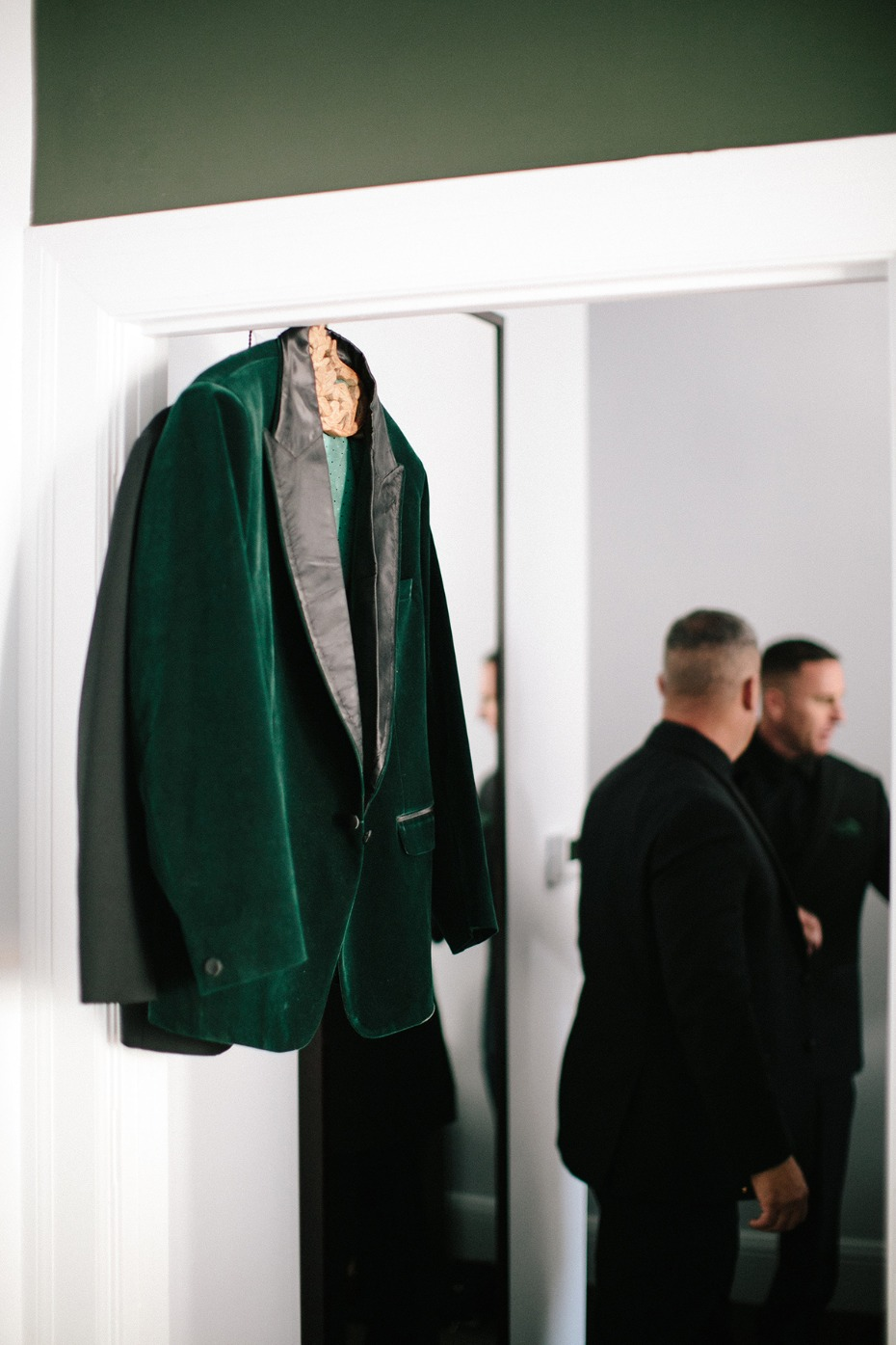 Emerald green groom jacket