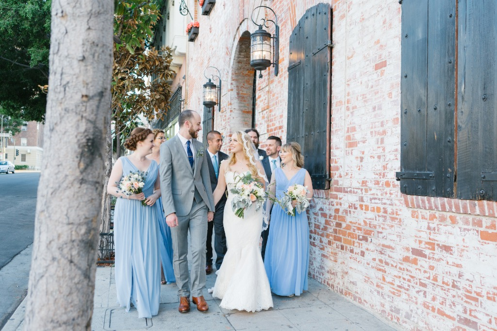 Love shooting candids of the bridal party having fun! This group was such a treat to work with. Soft blue bridesmaids dresses complemented