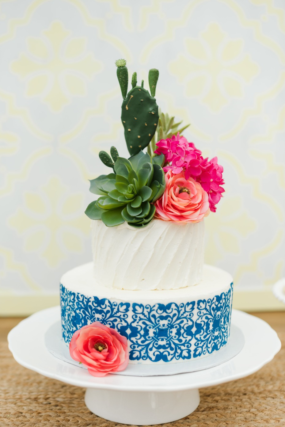 cactus and flower topped wedding cake